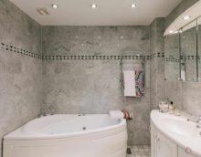 идея использования светлой декоративной штукатурки в интерьере ванной фото