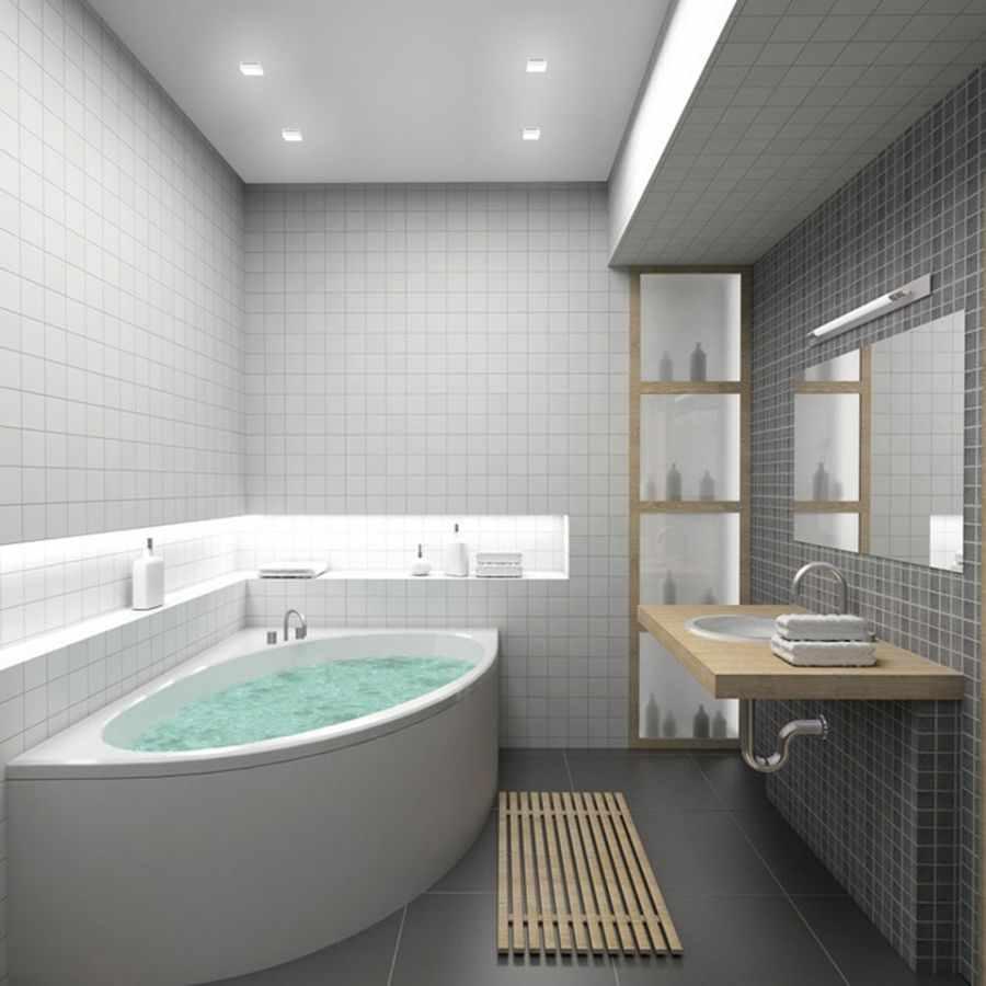 вариант светлого интерьера ванной комнаты с угловой ванной