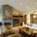 пример применения необычного дизайна гостиной комнаты с камином фото