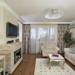 вариант использования красивого дизайна гостиной комнаты с камином фото