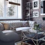 Удобный диван у кирпичной стены