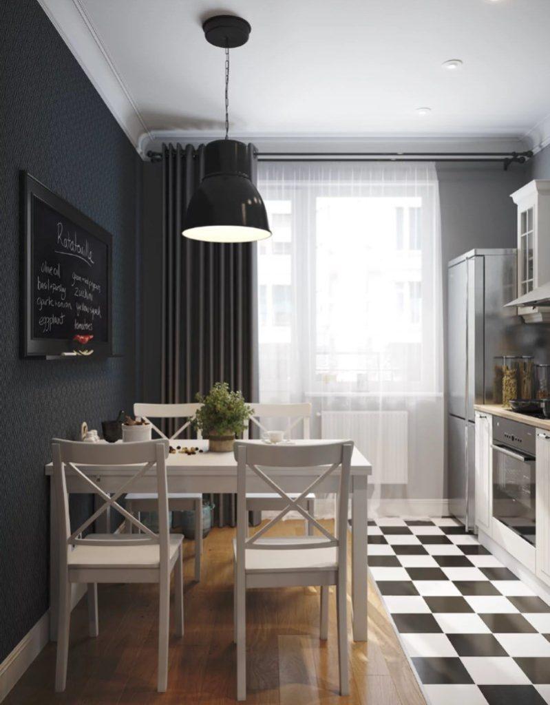 Светлый обеденный стол перед черной стеной на кухне в 8 квадратов