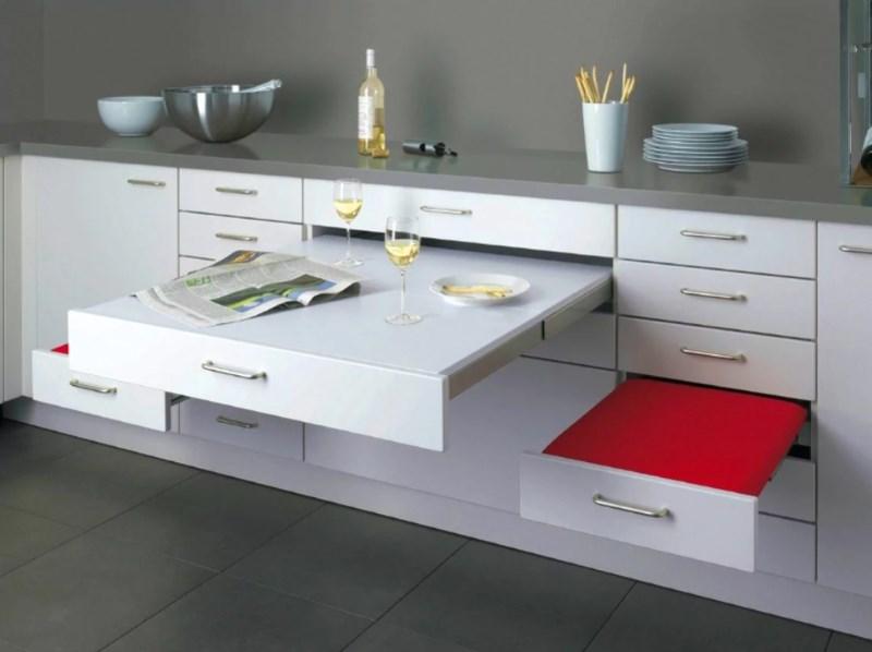Выдвижная мебель в дизайне маленькой кухни